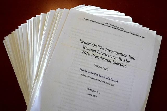FILE PHOTO - The Mueller Report on the Investigation into Russian Interference in the 2016 Presidential Election is pictured in New York, New York, U.S., April 18, 2019.   REUTERS/Carlo Allegri