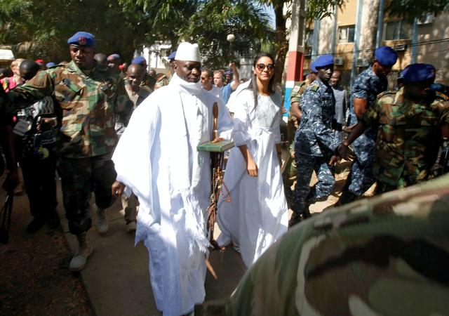 FILE PHOTO: Gambian President Yahya Jammeh arrives at a polling station with his wife Zineb during the presidential election in Banjul, Gambia, December 1, 2016. REUTERS/Thierry Gouegnon/File Photo
