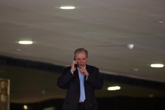 FILE PHOTO - Brazil's Economy Minister Paulo Guedes is seen before a ceremony of the Brazilian National Development Bank (BNDES) Line of Credit for Philanthropic Organizations at the Planalto Palace in Brasilia, Brazil June 13, 2019. REUTERS/Adriano Machado