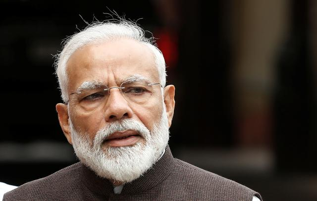 FILE PHOTO - India's Prime Minister Narendra Modi speaks with the media on the opening day of the parliament session in New Delhi, India, June 17, 2019. REUTERS/Adnan Abidi