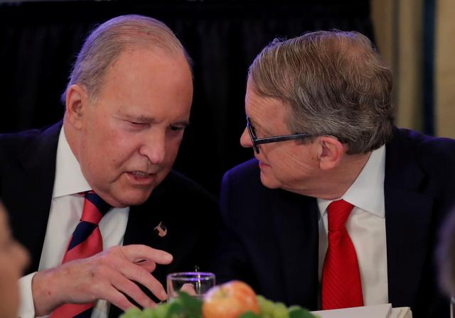 FILE PHOTO: White House economic adviser Larry Kudlow (L) speaks with Ohio Governor Mike DeWine at a meeting with U.S. Governors at the White House in Washington, U.S., February 25, 2019. REUTERS/Jim Young/File Photo