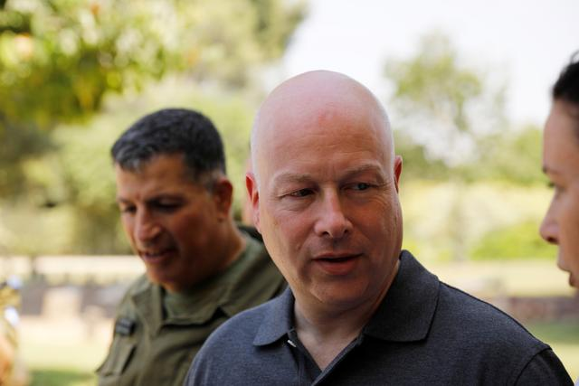 FILE PHOTO - Jason Greenblatt (C), U.S. President Donald Trump's Middle East envoy, arrives to visit Kibbutz Nahal Oz, just outside the Gaza Strip, in southern Israel August 30, 2017. REUTERS/Amir Cohen