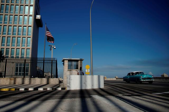 FILE PHOTO: A vintage car passes by the U.S. embassy in Havana, Cuba, March 12, 2019. Picture taken March 12, 2019. REUTERS/Alexandre Meneghini/File Photo