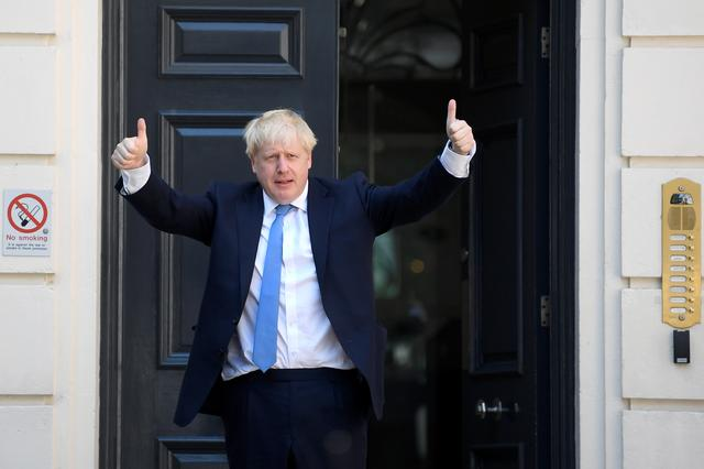 Boris Johnson gestures as he arrives at the Conservative Party headquarters, after being announced as Britain's next Prime Minister, in London, Britain July 23, 2019. REUTERS/Toby Melville