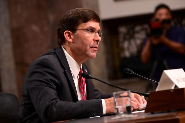 FILE PHOTO - Defense Secretary nominee Mark Esper testifies before a Senate Armed Services Committee hearing on his nomination in Washington, U.S. July 16, 2019. REUTERS/Erin Scott