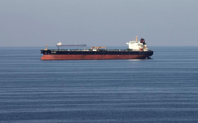 FILE PHOTO: Oil tankers pass through the Strait of Hormuz, December 21, 2018. REUTERS/Hamad I Mohammed/File Photo