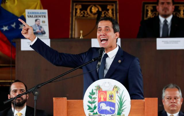 Venezuelan opposition leader Juan Guaido, who many nations have recognised as the country's rightful interim ruler, gestures as he speaks during a session of Venezuela's National Assembly at a public square in Caracas, Venezuela July 23, 2019. REUTERS/Carlos Garcia Rawlins
