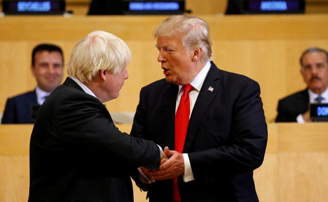 FILE PHOTO: U.S. President Donald Trump shakes hands with British Foreign Secretary Boris Johnson (L) as they take part in a session on reforming the United Nations at U.N. Headquarters in New York, U.S., September 18, 2017.   REUTERS/Kevin Lamarque/File Photo