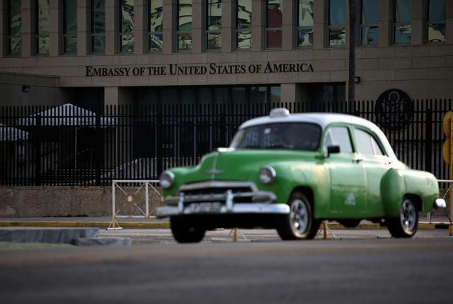 A vintage car drives past the U.S. embassy, in Havana, Cuba July 23, 2019. REUTERS/Fernando Medina