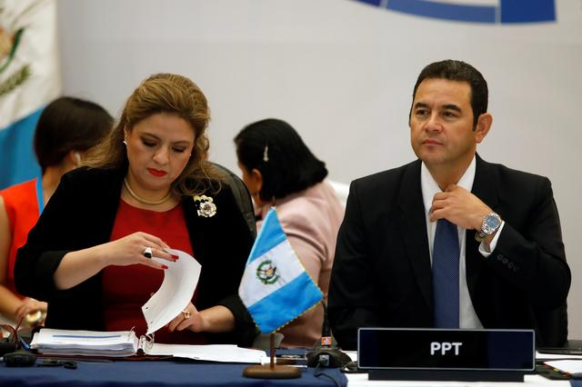 FILE PHOTO - Guatemala's President Jimmy Morales and Foreign Minister Sandra Jovel are seen during a meeting of the Central American Integration System (SICA), in Guatemala City, Guatemala June 5, 2019. REUTERS/Luis Echeverria