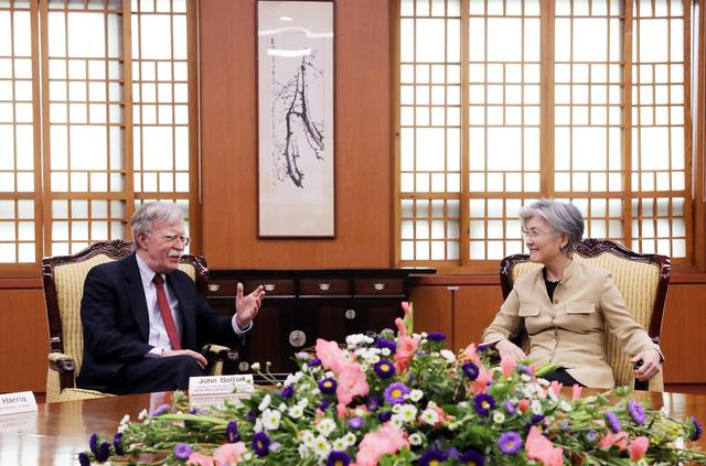 U.S. National Security Adviser John Bolton talks with South Korean Foreign Minister Kang Kyung-wha at the Foreign Ministry in Seoul, South Korea, July 24, 2019.    Yonhap via REUTERS