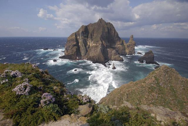 FILE PHOTO: A general view shows a part of the group of islets known in South Korea as Dokdo and in Japan as Takeshima in the Sea of Japan October 20, 2007. REUTERS/Yuri Maltsev/File Photo