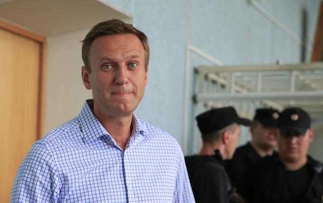 FILE PHOTO: Russian opposition leader Alexei Navalny, who is charged with participation in an unauthorised protest rally, attends a court hearing in Moscow, Russia July 1, 2019. REUTERS/Tatyana Makeyeva/File Photo