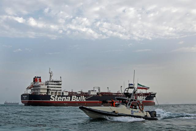 FILE PHOTO: A boat of Iranian Revolutionary Guard sails next to Stena Impero, a British-flagged vessel owned by Stena Bulk, at Bandar Abbas port, July 21, 2019. Iran, Mizan News Agency/WANA Handout via REUTERS/File Photo