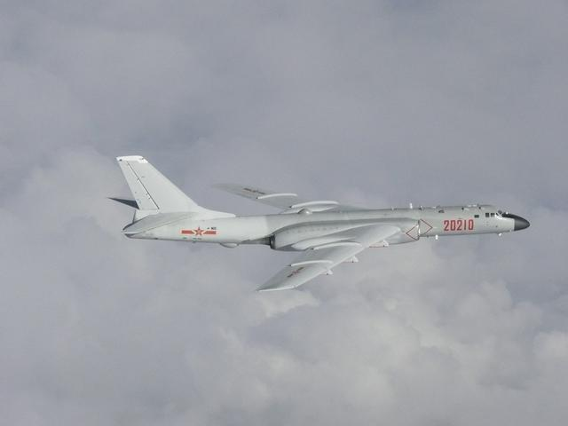 FILE PHOTO: A Chinese H-6 bomber flies over East China Sea in this handout picture taken by Japan Air Self-Defence Force and released by the Joint Staff Office of the Defense Ministry of Japan July 23, 2019. Joint Staff Office of the Defense Ministry of Japan/HANDOUT via REUTERS/File Photo