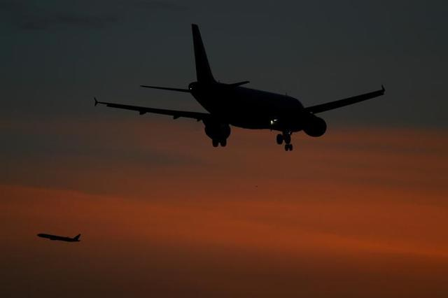 FILE PHOTO: Aircraft come in to land and take off from Heathrow airport in London, Britain, October 30 2017. REUTERS/Toby Melville
