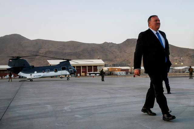 FILE PHOTO: Secretary of State Mike Pompeo walks from a helicopter to return to his plane at the end of an unannounced visit to Kabul, Afghanistan, June 25, 2019. Jacquelyn Martin/Pool via REUTERS