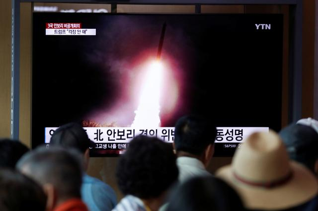 People watch a TV showing a file picture of a North Korean missile for a news report on North Korea firing short-range ballistic missiles, in Seoul, South Korea, August 2, 2019.    REUTERS/Kim Hong-Ji