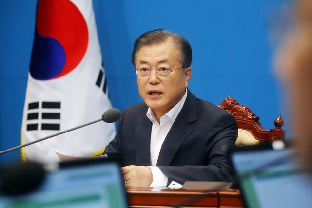 South Korean President Moon Jae-in speaks during an irregular cabinet meeting at the Presidential Blue House in Seoul, South Korea, August 2, 2019. Yonhap via REUTERS
