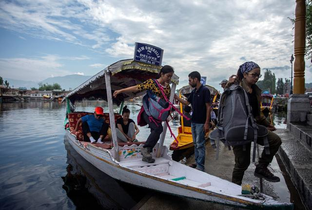 Foreign tourists disembark from a boat on the banks of Dal Lake as they prepare to leave Srinagar August 3, 2019. REUTERS/Stringer NO ARCHIVES. NO RESALES.