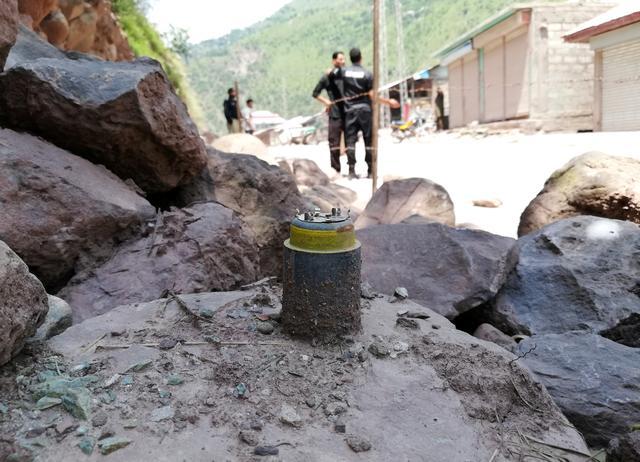 A cluster bomb shell is seen along a roadside in Noseri, near the line of control (LOC), in Neelum Valley in Kashmir August 4, 2019. REUTERS/M. Saif ul Islam