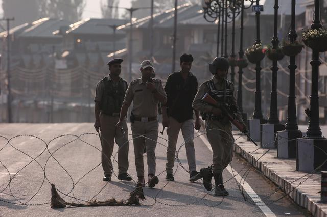 Indian security personnel patrol on deserted road during restrictions in Srinagar, August 5, 2019. REUTERS/Danish Ismail