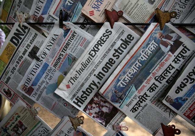 Newspapers, with headlines about Prime Minister Narendra Modi's decision to revoke special status for the disputed Kashmir region, are displayed for sale at a pavement in Ahmedabad, India, August 6, 2019. REUTERS/Amit Dave