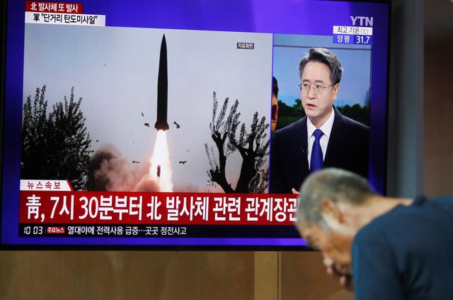 A man watches a TV showing a file picture for a news report on North Korea firing two unidentified projectiles, in Seoul, South Korea, August 6, 2019.    REUTERS/Kim Hong-Ji