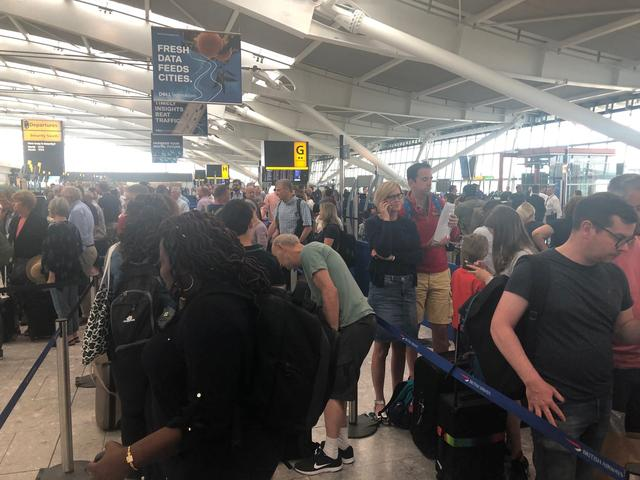 Passengers wait in long queues at Heathrow Airport as IT problems caused flight delays in London, Britain, August 7, 2019 in this picture obtained from social media. Paul Trickett via REUTERS