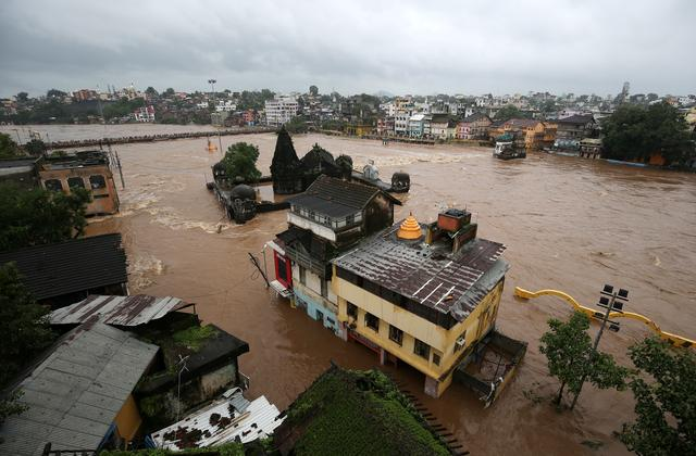 FILE PHOTO: Houses are seen submerged in the waters of overflowing river Godavari after heavy rainfall in Nashik, India, August 5, 2019. REUTERS/Francis Mascarenhas