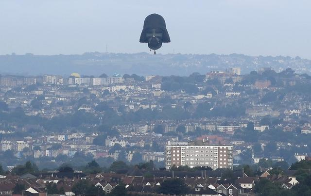 A balloon shaped as the head of fictional Star Wars film character Darth Vader is seen flying at the annual Bristol hot air balloon festival in Bristol, Britain, August 8, 2019. REUTERS/Toby Melville