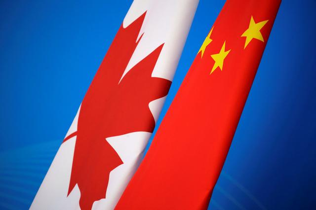 Flags of Canada and China are placed for the first China-Canada economic and financial strategy dialogue in Beijing, China, November 12, 2018. REUTERS/Jason Lee/Pool
