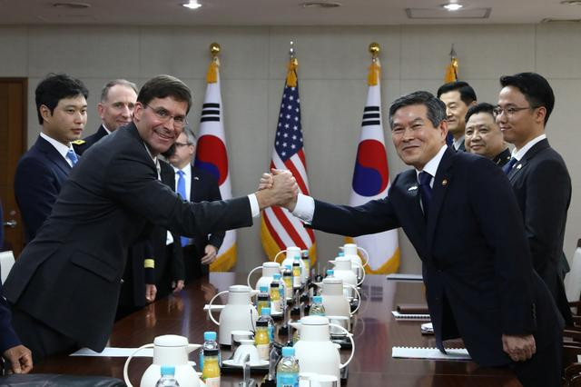 U.S. Defense Secretary Mark Esper clasps hands with South Korean Defense Minister Jeong Kyeong-doo during their meeting in Seoul, South Korea, August 9, 2019. Chung Sung-Jun/Pool via REUTERS
