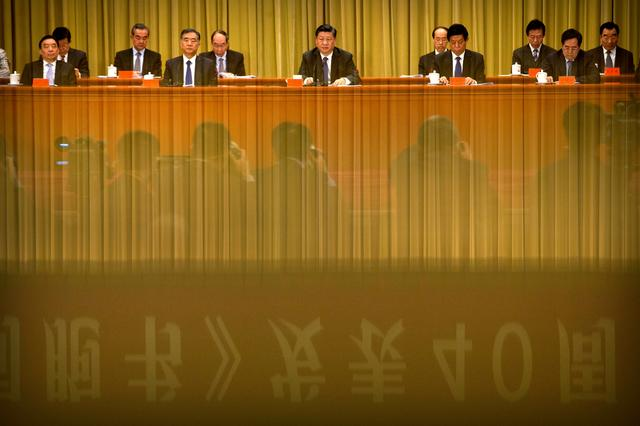 """FILE PHOTO: A banner is reflected on a polished surface as Chinese President Xi Jinping (C) speaks during an event to commemorate the 40th anniversary of the """"Message to Compatriots in Taiwan"""" at the Great Hall of the People in Beijing, China January 2, 2019. Mark Schiefelbein/Pool via REUTERS/File Photo"""