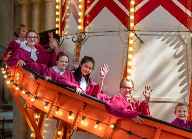 Helter Skelter, a fairground attraction is seen as part of the launch of 'Seeing it Differently' project at Norwich Cathedral, Britain August 8, 2019, in this still image obtained from social media by REUTERS on August 9, 2019. Norwich Cathedral/Bill Smith via REUTERS  Norwich Cathedral/Bill Smith