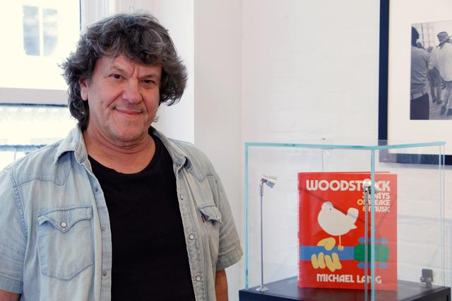 Woodstock producer Michael Lang poses during a photo exhibit that celebrates the 50th anniversary of Woodstock in New York, U.S., August 9, 2019.  REUTERS/Alicia Powell