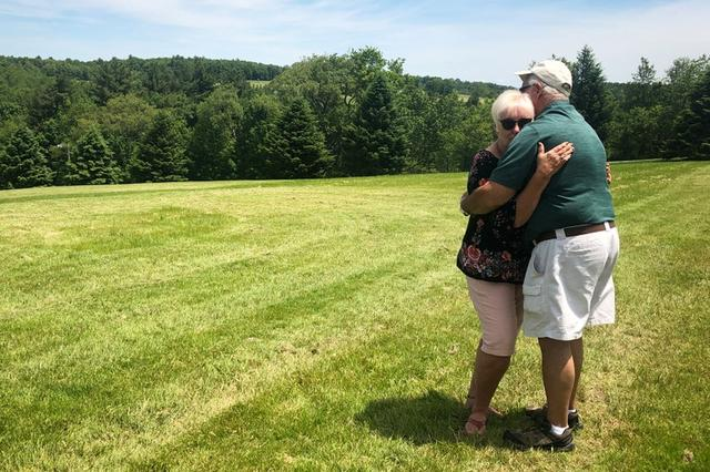 Nick and Bobbi Ercoline, the couple featured on the Woodstock album cover, pose together, at the site where the photo was taken 50 years ago, in Bethel, New York, U.S., June 12, 2019. REUTERS/Dan Fastenberg