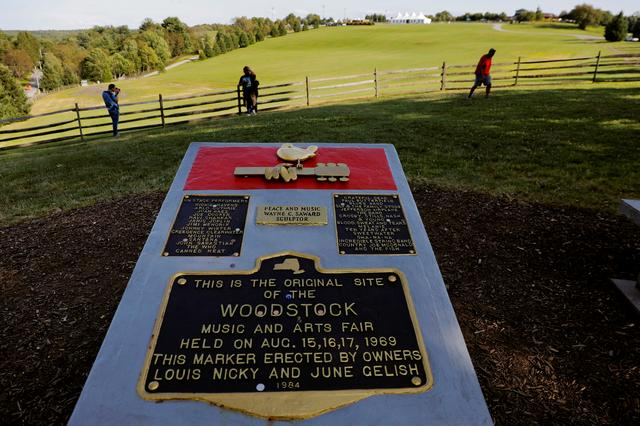 FILE PHOTO: A memorial stands above the original site of the Woodstock Music Festival while visiting to celebrate the 50th anniversary of the infamous Woodstock Music Festival in Bethel, New York, U.S., August 9, 2019. REUTERS/Lucas Jackson/File Photo