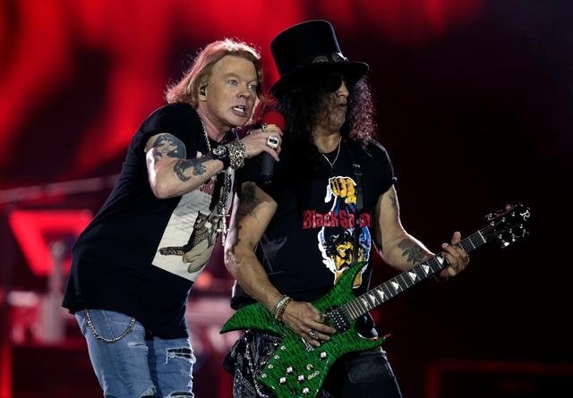 "Axl Rose and Slash, lead singer and lead guitarist of U.S. rock band Guns N' Roses, perform during their ""Not in This Lifetime... Tour"" at the du Arena in Abu Dhabi, United Arab Emirates November 25, 2018. REUTERS/Christopher Pike"