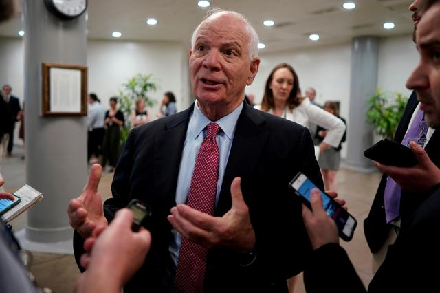 FILE PHOTO: U.S. Senator Ben Cardin (D-MD) speaks with reporters ahead of the weekly policy luncheons on Capitol Hill in Washington, U.S., May 7, 2019. REUTERS/Aaron P. Bernstein/File Photo