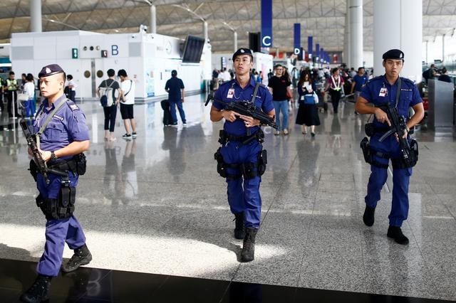 Armed police patrol the departure hall of the airport in Hong Kong after clashes with protesters, China August 14, 2019.  REUTERS/Thomas Peter