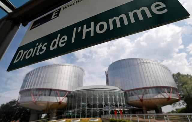 FILE PHOTO: A board at a tram stop reads Human rights in front of the European Court of Human Rights in Strasbourg, July 26, 2013. REUTERS/Vincent Kessler/File Photo