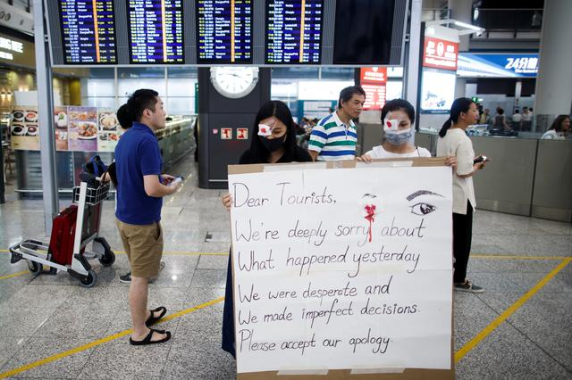 Anti-government demonstrators apologize for yesterday's clashes with police at the airport in Hong Kong China August 14, 2019.  REUTERS/Thomas Peter