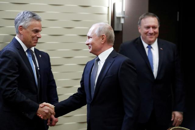 FILE PHOTO: Russian President Vladimir Putin shakes hands with U.S. Ambassador to Russia Jon Huntsman, left, as U.S. Secretary of State Mike Pompeo stands behind prior to their talks in the Black Sea resort city of Sochi, Russia, May 14, 2019. Pavel Golovkin/Pool via REUTERS/File Photo