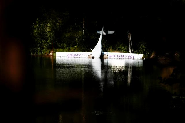 Norway's first battery-powered aircraft piloted by Avinor Chief Executive Dag Falk-Petersen is seen partly submerged in a lake after crash-landing, in Nornestjonn, Arendal, Norway, August 14, 2019. NTB Scanpix/Hakon Mosvold Larsen via REUTERS