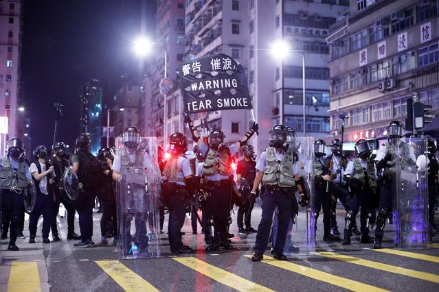 Police stand at a junction in the Sham Shui Po neighbourhood during clashes with anti-extradition bill protesters in Hong Kong, China, August 14, 2019.  REUTERS/Thomas Peter