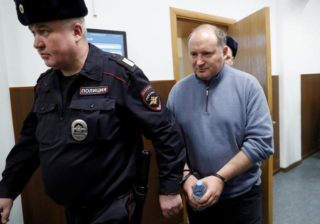Partner in the Baring Vostok private equity group Philippe Delpal, who was detained on suspicion of fraud, is escorted inside a court building in Moscow, Russia February 15, 2019. REUTERS/Tatyana Makeyeva