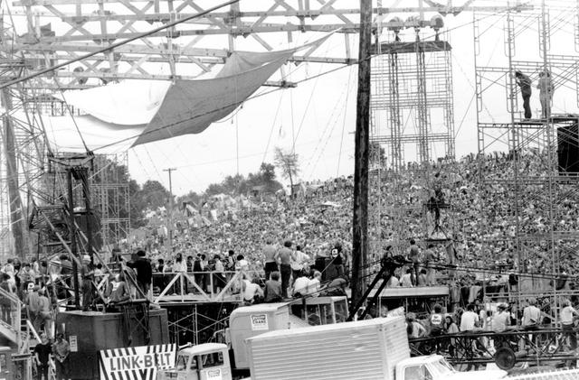 FILE PHOTO: Attendees watch performing artists at the Woodstock Music Festival in August 1969, Bethel, New York, U.S. in this handout image. James Sarles/The Museum at Bethel Woods/Via REUTERS.  MANDATORY CREDIT. MUST COURTESY  ©JAMES SARLES AND THE MUSEUM AT BETHEL WOODS.