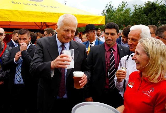 Prince Hans-Adam II of Liechtenstein takes a beer from a waitress during a party celebrating the country's 300th birthday in the gardens of Schloss Vaduz castle in Vaduz, Liechtenstein August 15, 2019. REUTERS/Arnd Wiegmann
