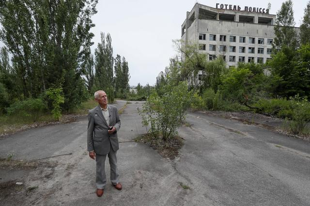 Ukrainian military pilot Mykola Volkozub looks around as he tries to find a place where he landed his helicopter in April 1986, in the abandoned city of Pripyat, near the Chernobyl nuclear power plant, Ukraine July 5, 2019.  REUTERS/Valentyn Ogirenko